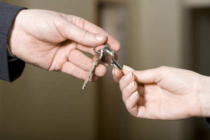 a man gives keys to a woman